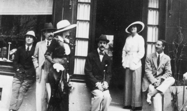 Gabrielle Coco Chanel and Boy Capel in front of Chanel's Deauville Boutique